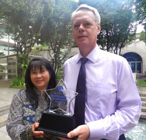 At right is Robert Guild, Director of the Pacific Department of the Asian Development Bank (ADB), holding the award with Marilou Drilon, senior natural resource economist of ADB's Pacific Department and head of the coordination unit for the Coral Triangle Pacific project.