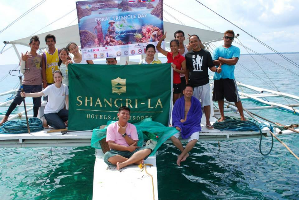 The staff of Shangri-La's Mactan Resort and Spa after scooping all floating debris stretching along Punta Engano Road shore.