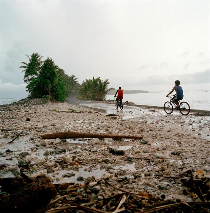 Low-lying stretches of atoll islands such as Fongafale, Tuvalu's most populous island, are sometimes overwashed by the highest spring tides, called king tides, which occur a few times a year.  (Photo by: Jocelyn Carlin, Panos Pictures)