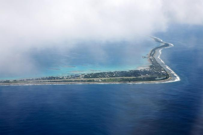 More than 6,000 Tuvaluans cram onto Fongafale, a boomerang-shaped sliver of land on the edge of a vast lagoon. The highest elevation on Fongafale is only a few yards above sea level, making the island vulnerable to rising seas. (Photo by: Koene/Hollandse Hoogte, Redux)