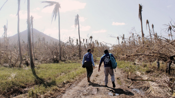 Staffers from the International Organization for Migration assess damage left by Cyclone Pam in Emae Island in Vanuatu. Representatives gathered for the Pacific Islands Forum Foreign Ministers Meeting will be seeking to strengthen national leadership though supportive regional responses to natural hazards. (Photo by: Joe Lowry / IOM / CC BY-NC-ND)