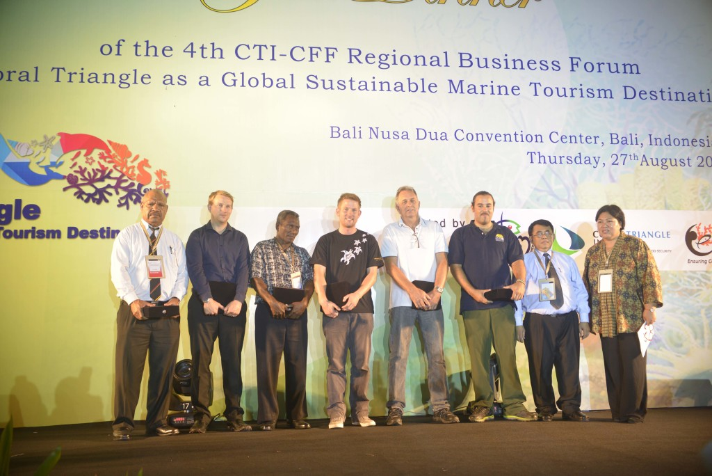(L to R) Representative Madang Resort Hotel, James Harvey of Reef World in behalf of Evolution Dive Resort, Patson Baea of Oravae Cottage, David McCann of Scuba Junkie, Chris Brown of Reef Seen, and Francisco Mesina of Dive Timor Lorosae. Standing next to them are CTI-CFF Regional Secretariat Executive Director Widi Pratikto and Coral Triangle Center Executive Director Rili Djohani. (Photo from: CTI-CFF and WWF)